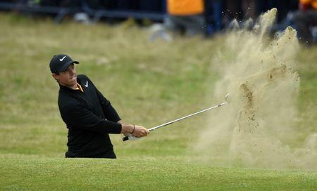 Jul 23, 2017; Southport, ENG; Rory McIlroy plays from a bunker on the 18th hole during the final round of The 146th Open Championship golf tournament at Royal Birkdale Golf Club. Mandatory Credit: Ian Rutherford-USA TODAY Sports