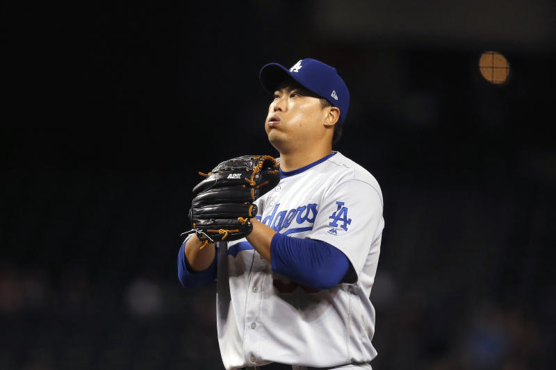 Los Angeles Dodgers starting pitcher Hyun-Jin Ryu, of South Korea, pauses on the mound during the first inning of the team's baseball game against the Arizona Diamondbacks on Thursday, Aug. 29, 2019, in Phoenix. (AP Photo/Ross D. Franklin)