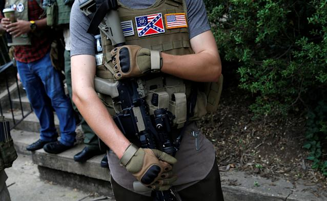 <p><span>A member of a white supremacists militia stands near a rally in Charlottesville, Virginia, U.S., August 12, 2017. (Photo: Joshua Roberts/Reuters)</span> </p>