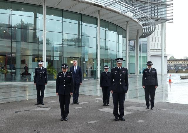 Metropolitan Police Commissioner Dame Cressida Dick (2nd left) and colleagues observe a minute's silence for police officer Sergeant Matt Ratana at the Empress State Building, London