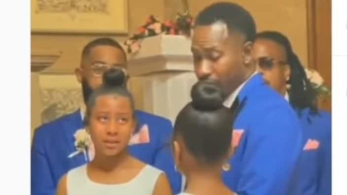 In a moving, now viral moment from a wedding in Detroit last month, Dontes Williams turned to his bride's two daughters and asked if they could be adopted.  (Instagram)