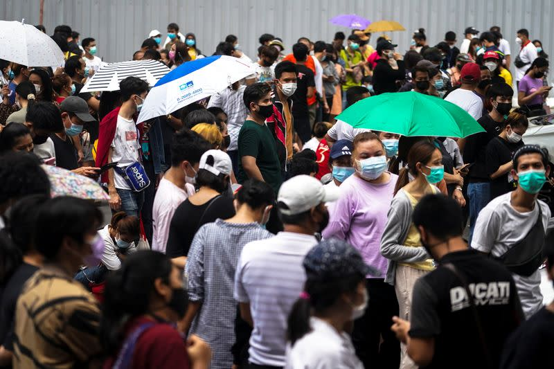 FILE PHOTO: Local residents queue for a COVID-19 nasal swab test in Bangkok