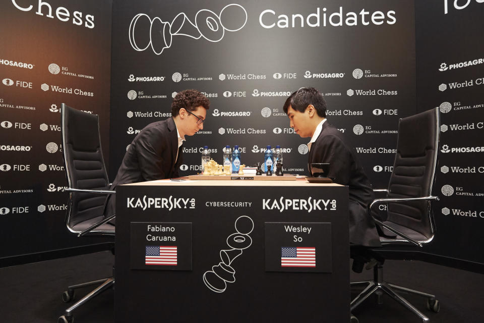 BERLIN, GERMANY - MARCH 10: (L-R) Fabiano Caruana and Wesley So are seen playing the first round at the First Move Ceremony during the World Chess Tournament on March 10, 2018 in Berlin, Germany. (Photo by Sebastian Reuter/Getty Images for World Chess)