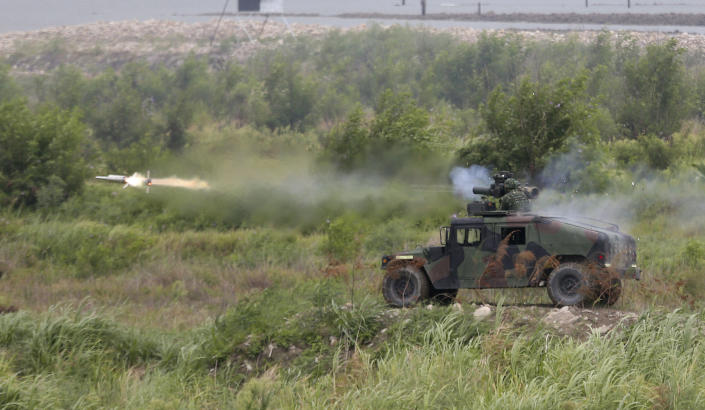 A BGM-71 anti-tank missile is fired during the 36th Han Kung military exercises in Taichung City, central Taiwan, Thursday, July 16, 2020. Taiwan's military fired missiles from the air and the island's shore facing China on Thursday in a live-fire exercise to demonstrate its ability to defend against any Chinese invasion. (AP Photo/Chiang Ying-ying)