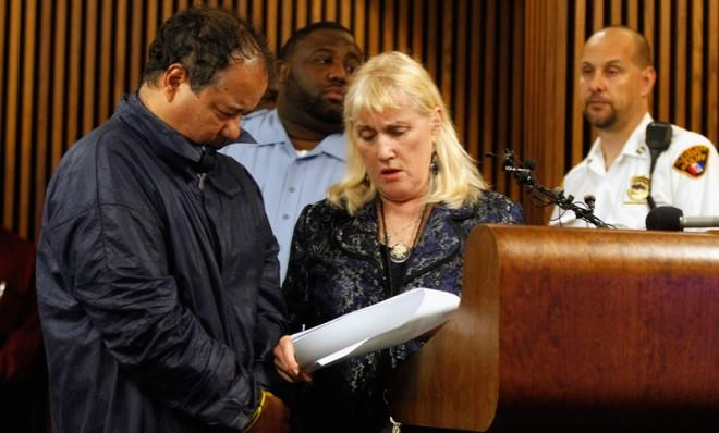Ariel Castro talks with his public defender during his arraignment in Cleveland, May 9.