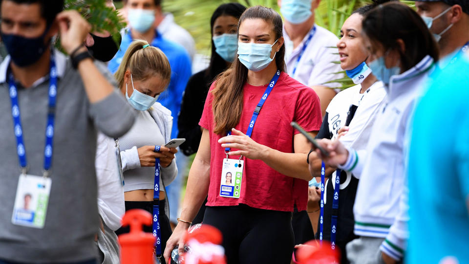 Australian Open players, pictured here waiting for a COVID-19 test in Melbourne.