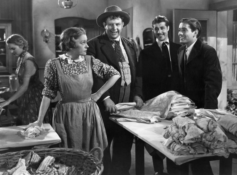 Alice Brady as Molly O'Leary, Andy Devine as Pickle Bixby, Don Ameche as Jack O'Leary, and Tyrone Power as Dion O'Leary in the 1937 film In Old Chicago. (Photo by John Springer Collection/CORBIS/Corbis via Getty Images)