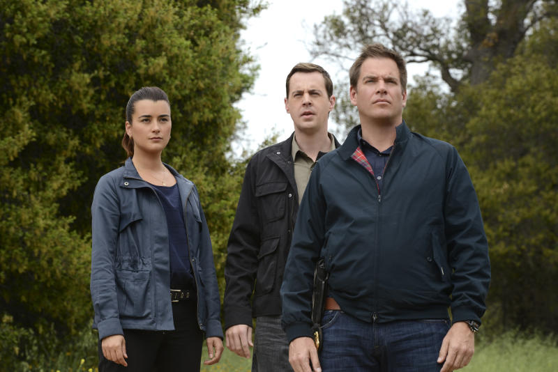 "This publicity image released by CBS shows, cast members, from left, Cote de Pablo, Sean Murray and Michael Weatherly in a scene from ""NCIS."" De Pablo will not be returning to the series. CBS Corp. chief executive Les Moonves said Monday, July 29, 2013, that every effort was made to keep actress Cote de Pablo on TV's highest-rated show, ""NCIS."" (AP Photo/CBS, Michael Yarish)"