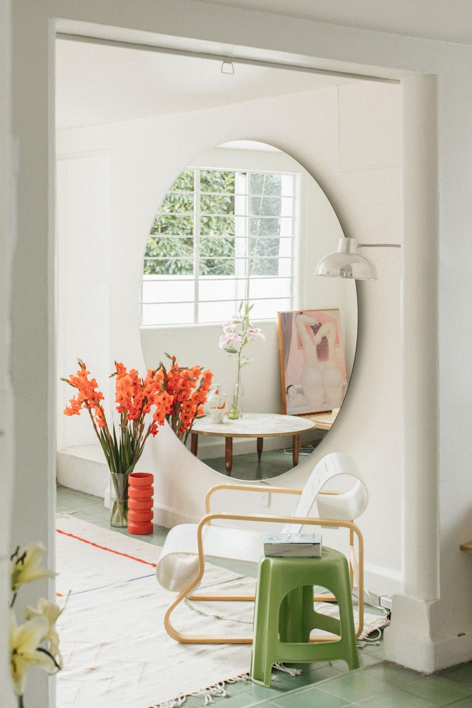 """<div class=""""caption""""> """"The white chair is the <a href=""""https://www.chairish.com/product/2358313/armchair-41-paimio-in-birch-and-white-by-alvar-aalto-artek?gclid=EAIaIQobChMIrJel0fPh6gIVF8DICh3cgwvGEAQYAyABEgKPP_D_BwE"""" rel=""""nofollow noopener"""" target=""""_blank"""" data-ylk=""""slk:41 by designer Alvar Aalto"""" class=""""link rapid-noclick-resp"""">41 by designer Alvar Aalto</a>. It is a gift from a friend who saw it as a nice reference to our collection —the roundness of the forms and purity of the lines,"""" says Charles. """"It is one of the first creations of the Finn, one of the pieces that makes it known, so it is a supportive message for young designers like us."""" </div>"""