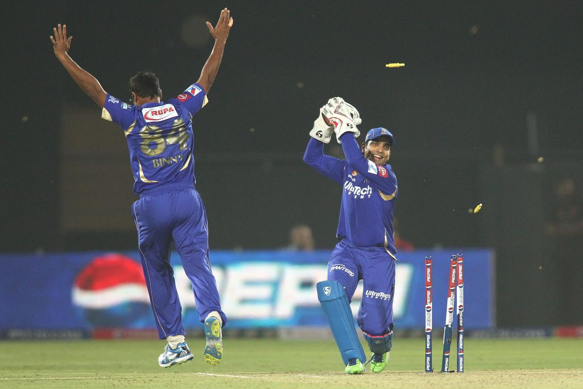 Dishant Yagnik of Rajasthan Royals breaks the stumps to run out Harbhajan Singh of Mumbai Indians as Stuart Binny of Rajasthan Royals celebrates during match 23 of the Pepsi Indian Premier League (IPL) 2013 between The Rajasthan Royals and the Mumbai Indians held at the Sawai Mansingh Stadium in Jaipur on the 17th April 2013..Photo by Shaun Roy-IPL-SPORTZPICS  ..Use of this image is subject to the terms and conditions as outlined by the BCCI. These terms can be found by following this link:..https://ec.yimg.com/ec?url=http%3a%2f%2fwww.sportzpics.co.za%2fimage%2fI0000SoRagM2cIEc&t=1506411499&sig=tMbEbfuPWUu_4RC0s_BW_w--~D