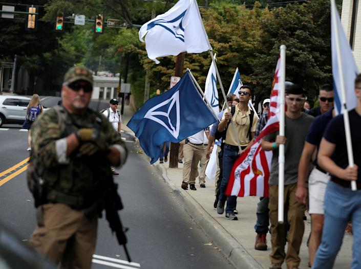 <p><span>White supremacists pass a militia member as the they arrive for a rally in Charlottesville, Virginia, U.S., August 12, 2017. (Photo: Joshua Roberts/Reuters)</span> </p>
