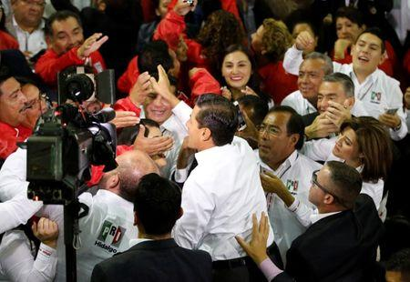 Mexican President Enrique Pena Nieto greets to supporters of the Institutional Revolutionary Party (PRI) during their national assembly ahead of the 2018 election at Mexico City's Palacio de los Deportes, Mexico August 12, 2017. REUTERS/Henry Romero