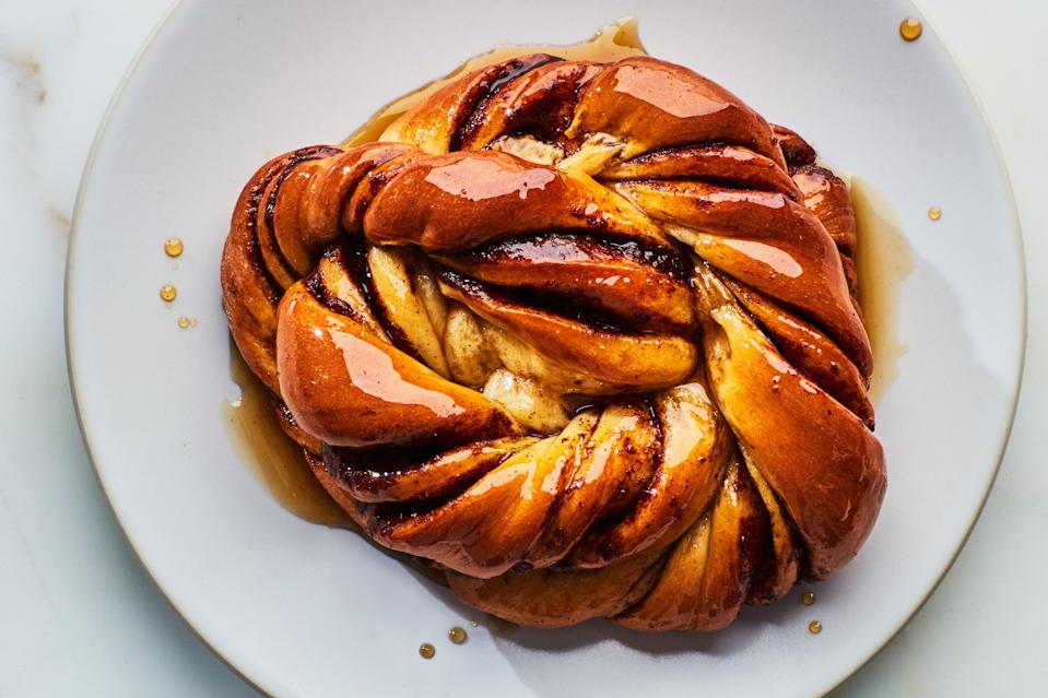 """These briochelike cardamom-scented rolls are a worthy project, whether you're looking for a special holiday brunch or just hoping to pass the time. <a href=""""https://www.epicurious.com/recipes/food/views/glazed-cinnamon-cardamom-buns?mbid=synd_yahoo_rss"""" rel=""""nofollow noopener"""" target=""""_blank"""" data-ylk=""""slk:See recipe."""" class=""""link rapid-noclick-resp"""">See recipe.</a>"""