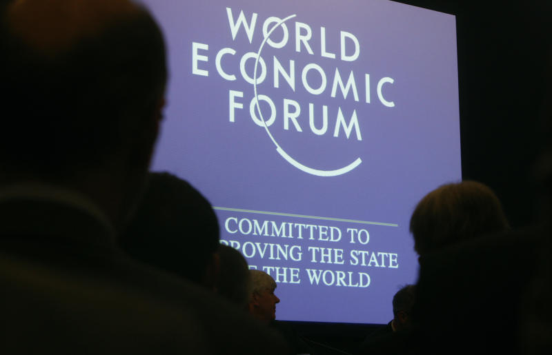 """Attendees listen to a session at the World Economic Forum in Davos, Switzerland on Wednesday, Jan. 26, 2011. Buoyed by a burst of optimism about the global economy and mindful of the """"new reality"""" that has framed it in the aftermath of the financial crisis some 2,500 business leaders, politicians and social activists will tackle an array of issues on the first day of the World Economic Forum. (AP Photo/Michel Euler)"""
