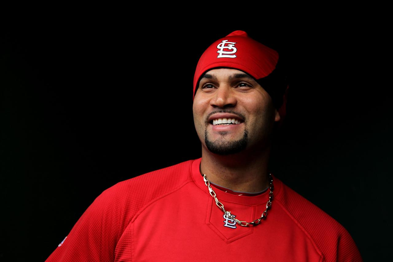 ST LOUIS, MO - OCTOBER 20: Albert Pujols #5 of the St. Louis Cardinals stands in the dugout prior to Game Two of the MLB World Series against the Texas Rangers at Busch Stadium on October 20, 2011 in St Louis, Missouri.  (Photo by Ezra Shaw/Getty Images)