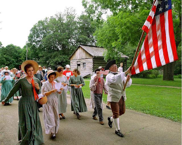 <p>Period interpreters lead the citizen's parade during an Independence Day celebration at Lincoln's New Salem State Historic Site near Petersburg, Ill., Sunday, July 4, 2010. Lincoln's New Salem State Historic Site is a reconstruction of the 1830s log village where Abraham Lincoln spent six years of his life. (Photo: Seth Perlman/AP) </p>