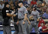 Arizona Diamondbacks' Nick Ahmed, right, is held back by third base coach Tony Perezchica as manager Torey Lovullo (17) speaks with umpire James Hoye, left, during the third inning of the team's baseball game against the San Diego Padres on Friday, Aug. 17, 2018, in San Diego. Ahmed was ejected by Hoye for arguing after striking out during his at-bat. (AP Photo/Gregory Bull)