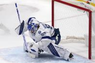 Tampa Bay Lightning goaltender Andrei Vasilevskiy blocks a shot from the Dallas Stars in the second period of an NHL hockey game in Dallas, Tuesday, March 2, 2021. (AP Photo/Tony Gutierrez)