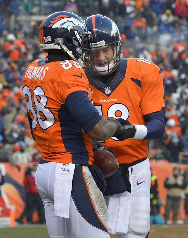 Denver Broncos wide receiver Demaryius Thomas, left, celebrates a touchdown with Peyton Manning during the second half of an NFL football game against the Tennessee Titans on Sunday, Dec. 8, 2013, in Denver. (AP Photo/Jack Dempsey)