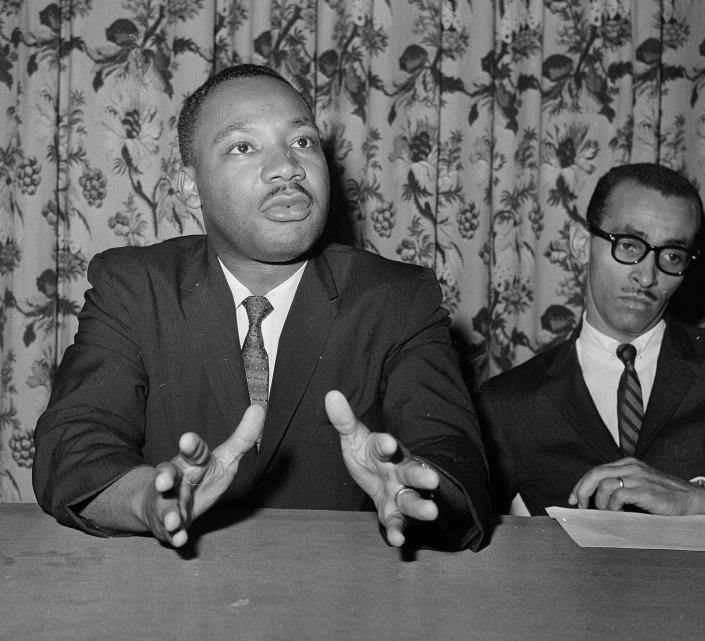<p>Rev. Dr. Martin Luther King, Jr., of Atlanta, Ga., left, asked that Pres. John F. Kennedy issues an executive order declaring all forms of racial segregation illegal at a press conference, June 5, 1961, New York. He also said that a speaking trip to the South by the President would be welcomed by many White persons as well as African Americans. (AP Photo) </p>