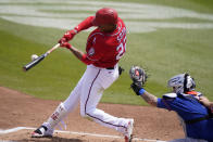 Washington Nationals' Juan Soto flies out to center field during the first inning of a spring training baseball game against the New York Mets, Sunday, March 21, 2021, in West Palm Beach, Fla. (AP Photo/Lynne Sladky)