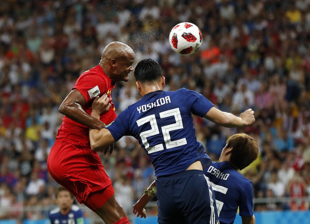 <p>Belgium's Vincent Kompany, left, and Japan's Maya Yoshida challenge for the ball during the round of 16 match between Belgium and Japan at the 2018 soccer World Cup in the Rostov Arena, in Rostov-on-Don, Russia, Monday, July 2, 2018. (AP Photo/Petr David Josek) </p>