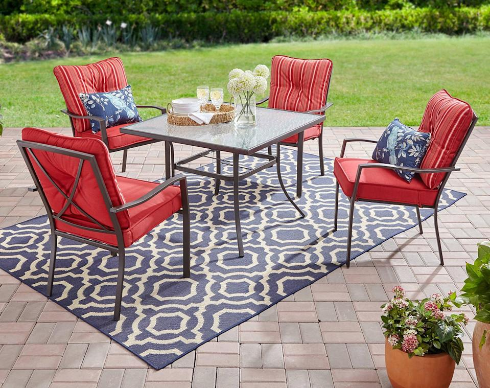 <p>You're going to spend a lot of time on your patio this season if you've got this <span>Mainstays Forest Hills 5-Piece Dining Set</span> ($225, originally $300).</p>