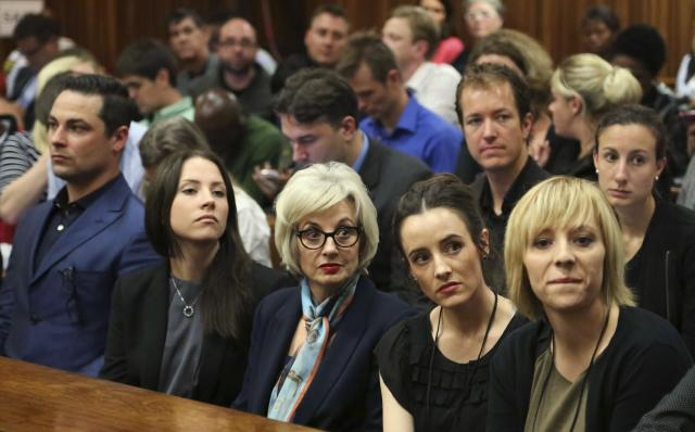 "The family members of Oscar Pistorius sit in court ahead of his trial at the North Gauteng High Court in Pretoria March 3, 2014. ""Blade Runner"" Pistorius arrived at the Pretoria High Court on Monday for the start of his murder trial, opening a decisive chapter in the story of the rise and fall of one of the world's best-known athletes.REUTERS/Themba Hadebe/Pool (SOUTH AFRICA - Tags: SPORT ATHLETICS CRIME LAW)"
