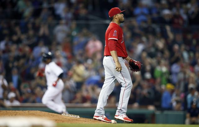 Los Angeles Angels' Jaime Barria walks off the mound after giving up a solo home run to Boston Red Sox's Rafael Devers, left, during the fifth inning of a baseball game in Boston, Thursday, June 28, 2018. (AP Photo/Michael Dwyer)