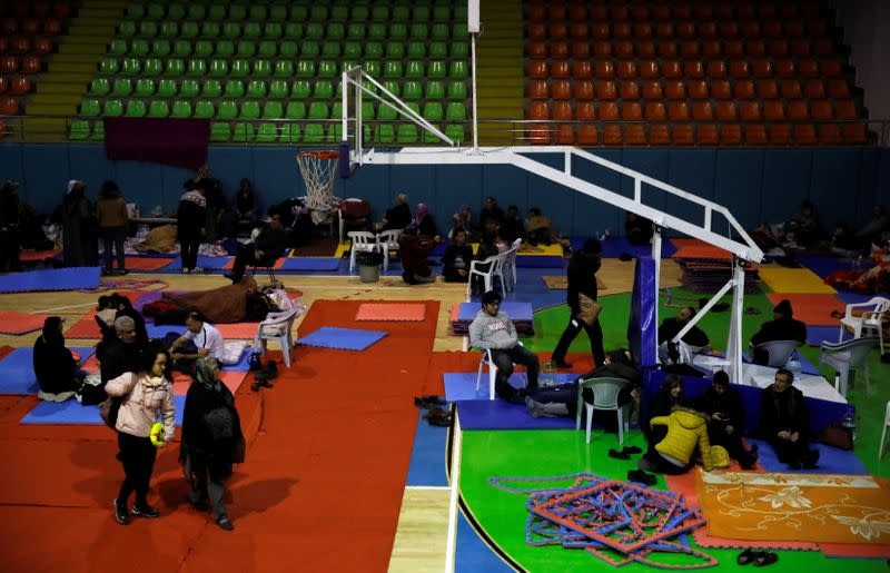 People rest at a temporary shelter camp in a basketball arena, after an earthquake in Elazig