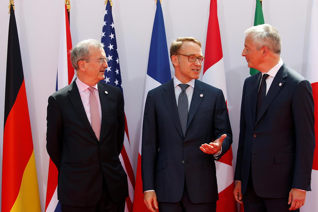 French Finance Minister Bruno Le Maire and Governor of the Bank of France Francois Villeroy de Galhau welcome German Bundesbank President Jens Weidmann at the G7 finance ministers and central bank governors meeting in Chantilly, near Paris, France, July 17, 2019. REUTERS/ Pascal Rossignol