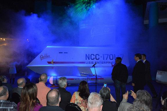 """""""Star Trek"""" superfan Adam Schneider and actor Don Marshall watch as the """"Galileo"""" shuttlecraft is revealed at Space Center Houston in Texas, July 31, 2013."""