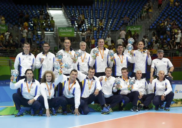 2016 Rio Paralympics - Sitting Volleyball - Victory Ceremony - Men's Gold Medal Match - Riocentro Pavilion 6 - Rio de Janeiro, Brazil - 18/09/2016. Players of team Bosnia and Herzegovina pose with their silver medals during the medal ceremony. REUTERS/Ueslei Marcelino FOR EDITORIAL USE ONLY. NOT FOR SALE FOR MARKETING OR ADVERTISING CAMPAIGNS.