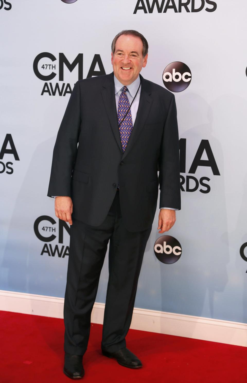 Former Arkansas Governor Mike Huckabee arrives at the 47th Country Music Association Awards in Nashville, Tennessee November 6, 2013. REUTERS/Eric Henderson (UNITED STATES - Tags: ENTERTAINMENT POLITICS)
