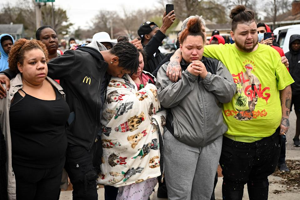 <p>Family and friends of Daunte Wright, 20, grieve at 63rd Avenue North and Lee Avenue North hours after they say he was shot and killed by police, Sunday, April 11, 2021, in Brooklyn Center, Minn. Wright's mother, Katie Wright, stands at center. </p> ((Aaron Lavinsky/Star Tribune via AP))