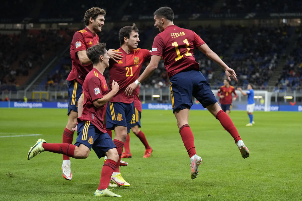 Spain's Ferran Torres, right, celebrates with teammates after scoring during the UEFA Nations League semifinal soccer match between Italy and Spain at the San Siro stadium, in Milan, Italy, Wednesday, Oct. 6, 2021. (AP Photo/Antonio Calanni)