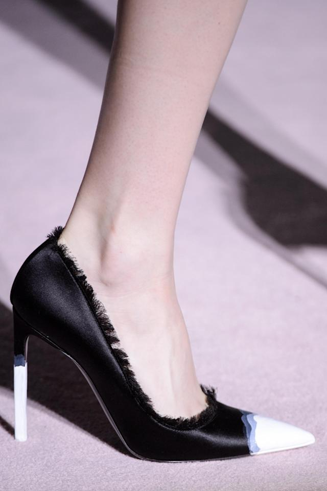<p><i>Black and white cap-toe heels with fringe edges from the SS18 Tom Ford collection. (Photo: ImaxTree) </i></p>