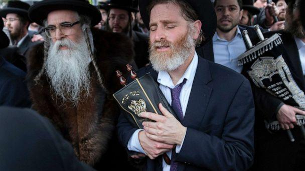 PHOTO: Community members, including Rabbi Chaim Rottenberg, left, celebrate the arrival of a new Torah near the rabbi's residence in Monsey, N.Y., Dec. 29, 2019. (Craig Ruttle/AP)