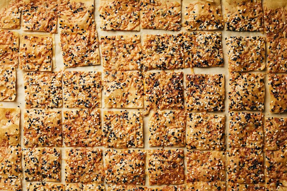 """Not feeling the squares in this phyllo bites recipe? Use a pizza cutter to cut crackers into any shape you like! <a href=""""https://www.epicurious.com/recipes/food/views/cheesy-sesame-phyllo-bites?mbid=synd_yahoo_rss"""" rel=""""nofollow noopener"""" target=""""_blank"""" data-ylk=""""slk:See recipe."""" class=""""link rapid-noclick-resp"""">See recipe.</a>"""