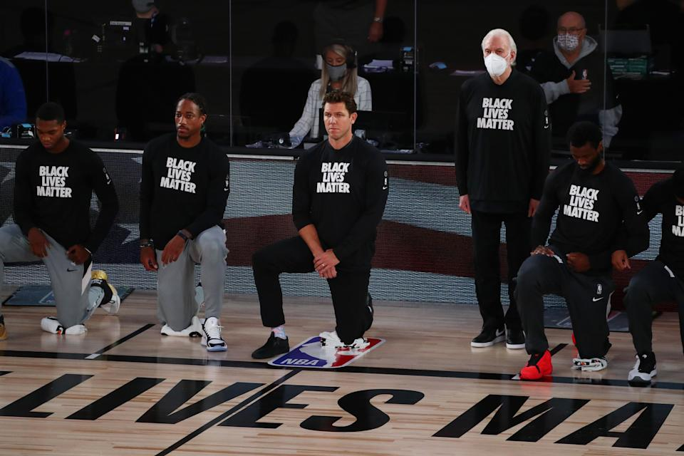 Gregg Popovich has openly supported his players' rights to protest racial injustice during the national anthem, but declined to join them on Friday. (Photo by Kim Klement - Pool/Getty Images)