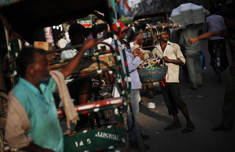 India PM vows no capital controls; growth slows