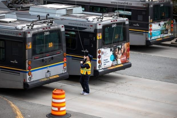 A TransLink employee at its bus depot in Vancouver in  April 2020 when hundreds of workers received layoff notices due to the pandemic.