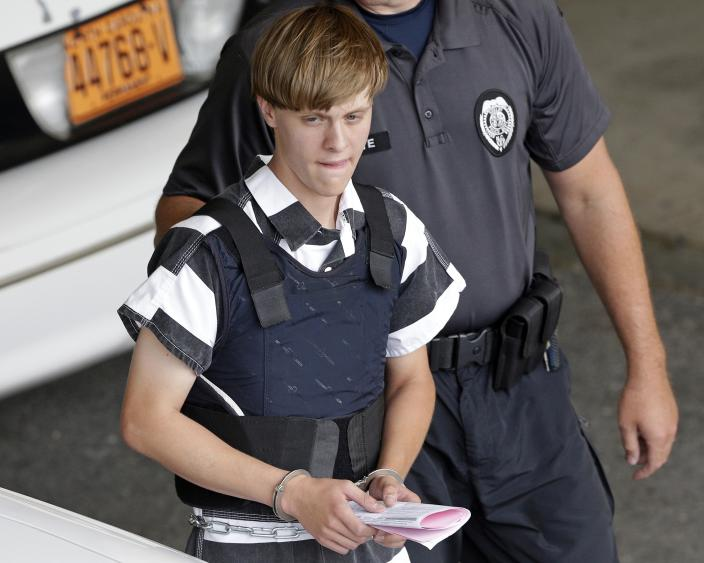 Dylann Roof was charged with multiple counts of federal hate crimes after killing nine people in a racist attack at a Charleston, S.C. church in 2015. (Chuck Burton/AP)