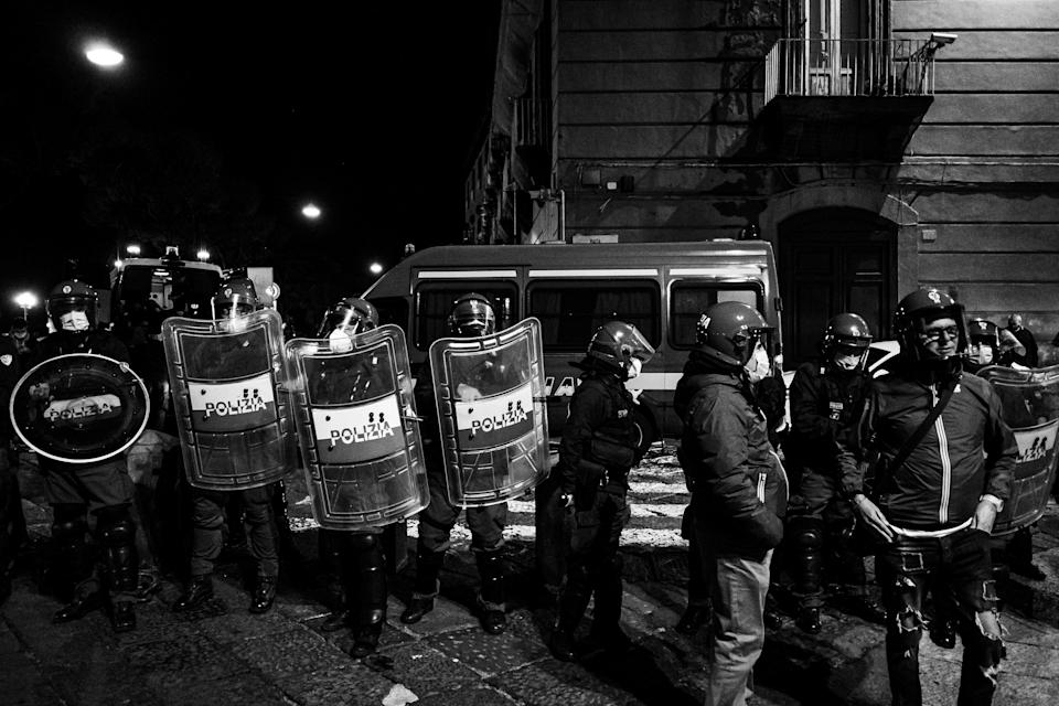 (EDITOR'S NOTE: Image was converted to black and white) Citizens together with shopkeepers protest in Piazza Plebiscito against the anti-Covid restrictions imposed by the Italian Government of Giuseppe Conte and the Regional Council of Governor Vincenzo De Luca, to limit the spread of the Covid-19 virus, in Naples, Italy, on 26 October 2020. After the last Dpcm of Giuseppe Conte's Italian Government, which establishes the closure of various commercial activities (gyms, cinemas, theatres, amusement arcades, wellness centres) and the closure at 6pm for restaurants, pubs and coffebars, until November 24th, bringing a series of protests and disapproval in many Italian squares by citizens and traders due to the loss of job opportunities. (Photo by Manuel Dorati/NurPhoto via Getty Images) (Photo: NurPhoto via Getty Images)