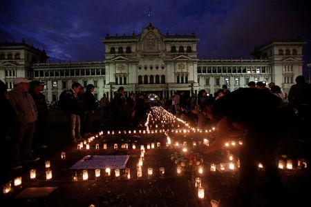 A vigil for victims after a fire broke out at the Virgen de Asuncion home in San Jose Pinula, on the outskirts of Guatemala City,
