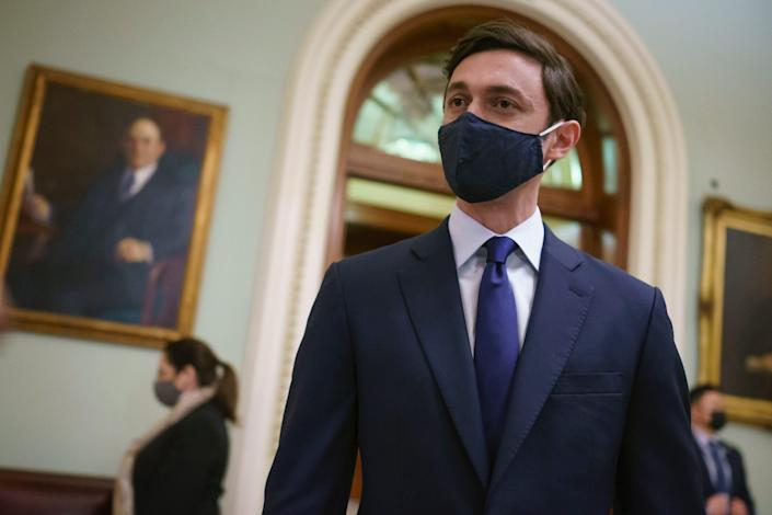 Sen. Jon Ossoff, D-Ga., speaks to reporters outside the Senate chamber just after being sworn-in by Vice President Kamala Harris, at the Capitol in Washington, Wednesday, Jan. 20, 2021.