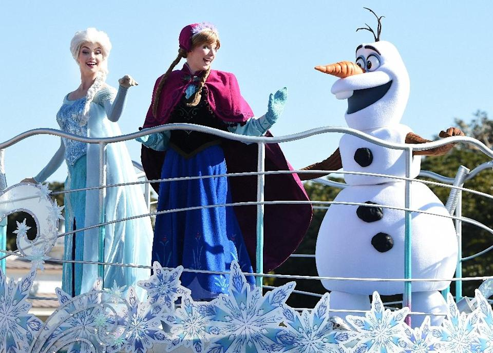 "Characters from the Disney movie 'Frozen' perform on a float during the new parade ""Anna and Elsa's Frozen Fantasy"" at Tokyo Disneyland in Urayasu on January 13, 2015 (AFP Photo/Toru Yamanaka)"