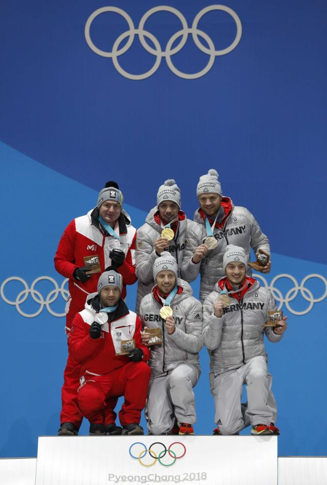 Medals Ceremony - Luge - Pyeongchang 2018 Winter Olympics - Men's Doubles - Medals Plaza - Pyeongchang, South Korea - February 16, 2018 - Gold medalists Tobias Wendl and Tobias Arlt of Germany, silver medalists Peter Penz and Georg Fischler of Austria and bronze medalists, Toni Eggert and Sascha Benecken of Germany on the podium. REUTERS/Eric Gaillard