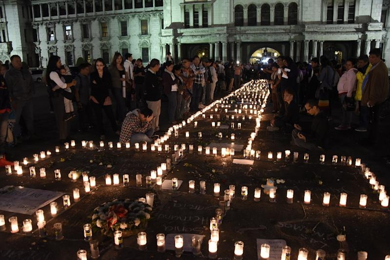 People take part in a protest at the Square of the Constitution in Guatemala City on March 9, 2017, following the death of 40 girls in a recent fire at a government-run children's shelter in San Jose Pinula, east of the capital (AFP Photo/JOHAN ORDONEZ)