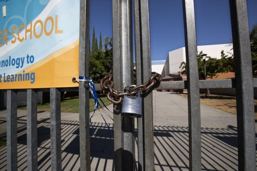 "A gate in front of Los Angeles High School was locked on July 13. <span class=""copyright"">(Mel Melcon / Los Angeles Times)</span>"